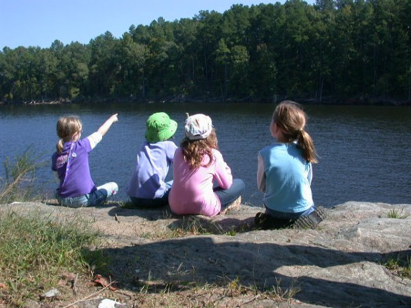 After a hike to Falls Lake from Rockcliff Farm, girls enjoy a rest and a view.